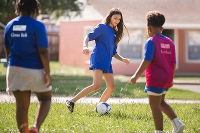 Kids Playing Soccer with Health First